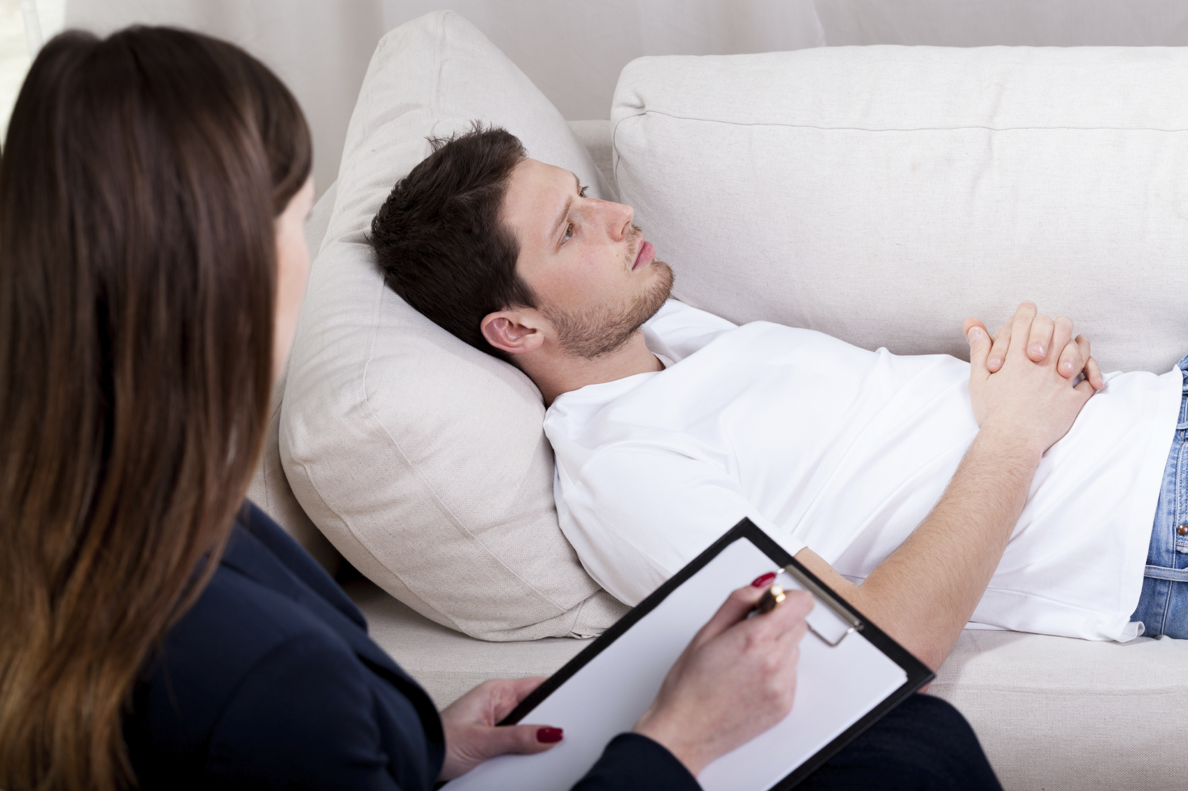 Therapist working with patient on hypnosis | Turning Point