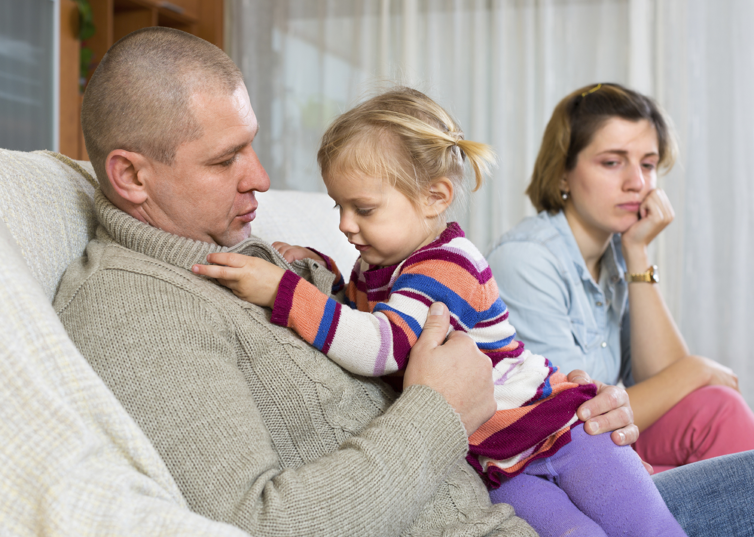 Family with little child having serious conflict at home